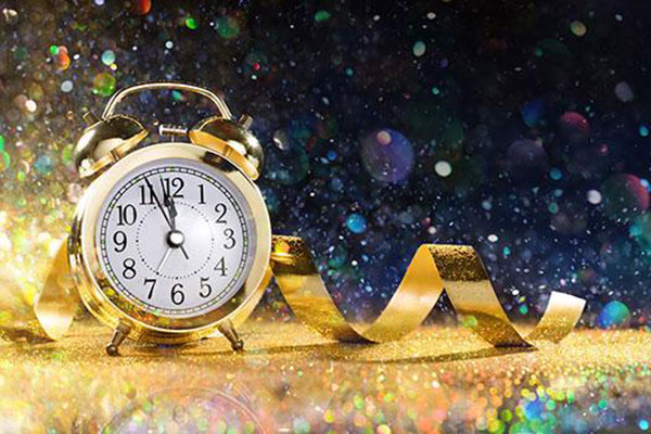 Gold clock counting down to new year's eve