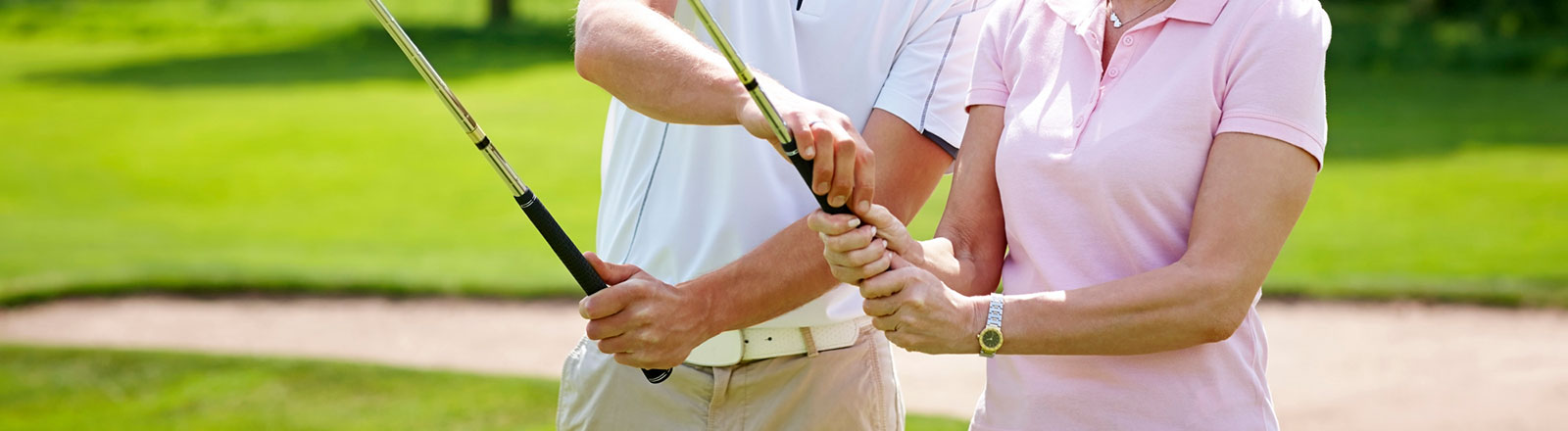 Woman having a golf lesson on grip